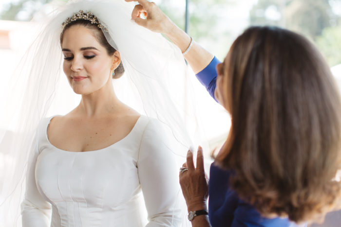 getting ready bride mother white dress veil